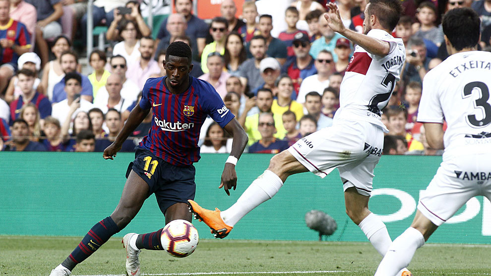 Ousmane Dembele dribbles during the match between FC Barcelona and SD...