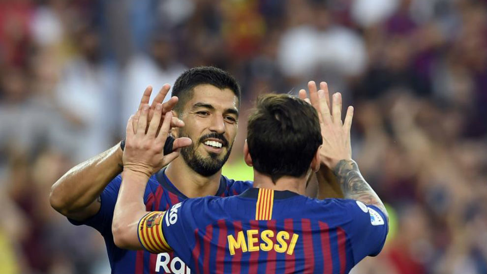Lionel Messi celebrates scoring his team's sixth goal with Luis Suarez
