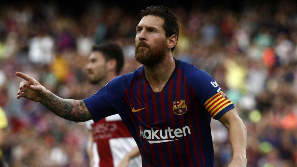 Messi celebrates scoring opening goal during the LaLiga match between...