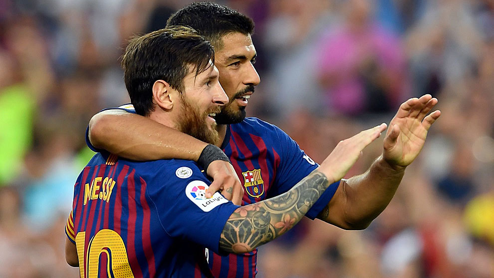 Messi and Suarez celebrate scoring during the match between FC...