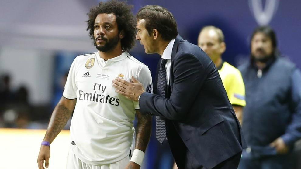 Real Madrid's Spanish coach Julen Lopetegui speaks to Brazilian...