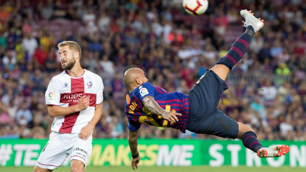 Vidal kicks the ball during the Spanish league football match between...
