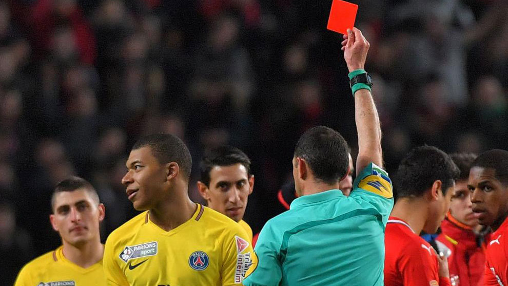 Kylian Mbappe reacts as the referee gives him a red card