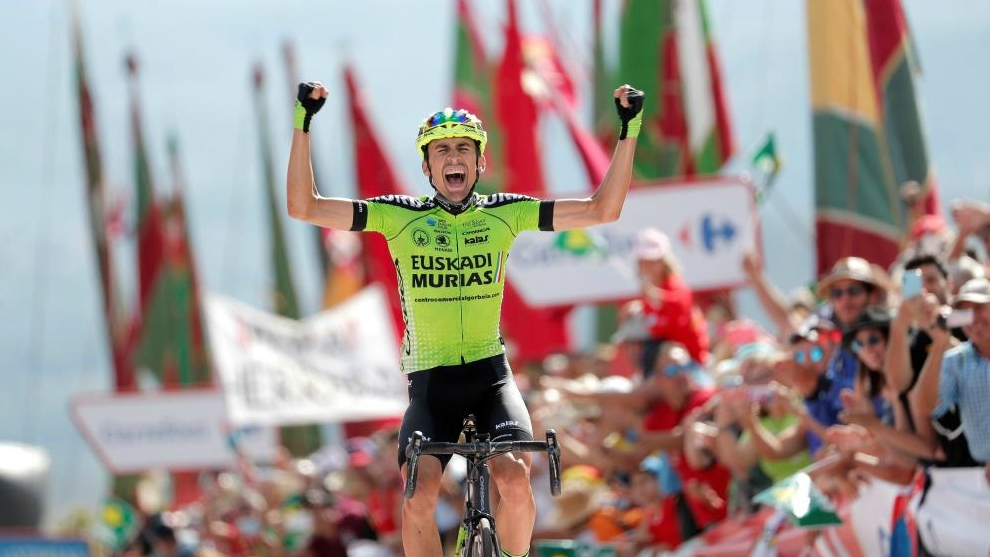 Oscar Rodriguez celebrates as he wins the 13th stage