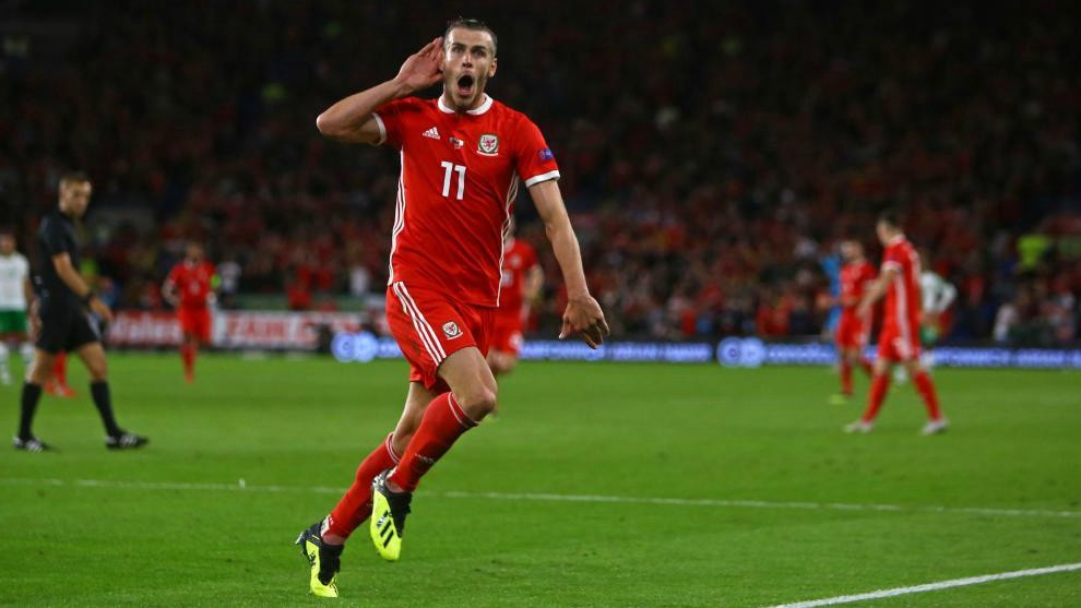 Real Madrid forward Gareth Bale celebrates scoring for Wales.