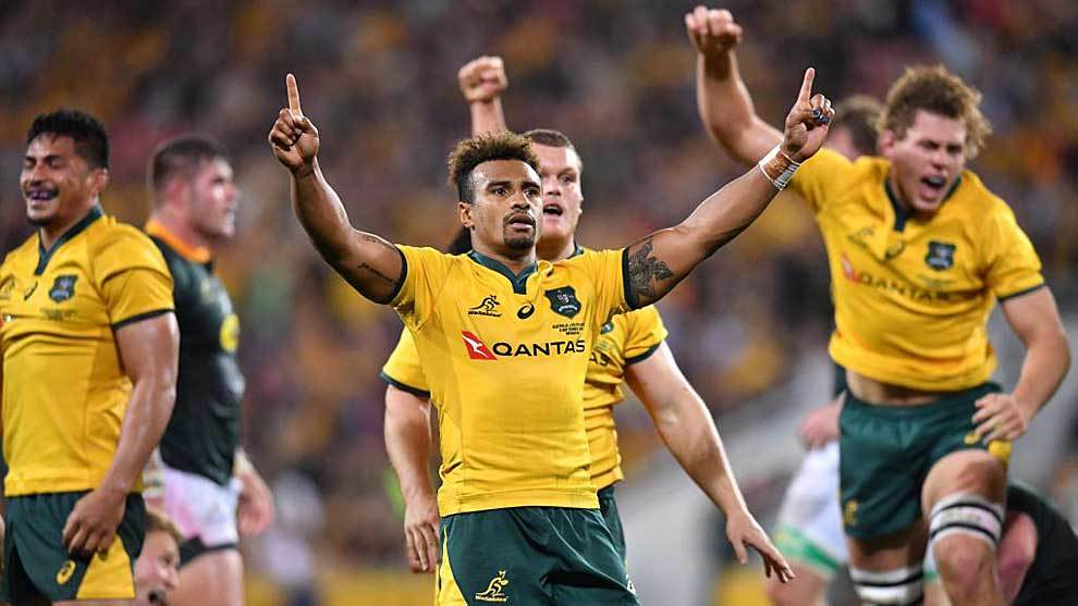 Will Genia y sus compañeros celebran el triunfo sobre Sudáfrica