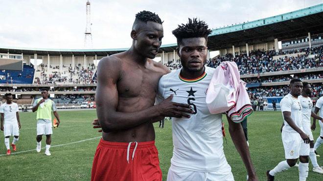 Kenya's forward Ogada Michael Olunga congratulates Ghana's midfielder...