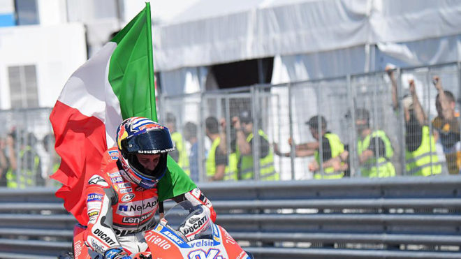 Andrea Dovizioso arrives in the pits after winning the MotoGP race of...
