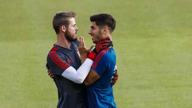 David de Gea y Marco Asensio, durante un entrenamiento de España