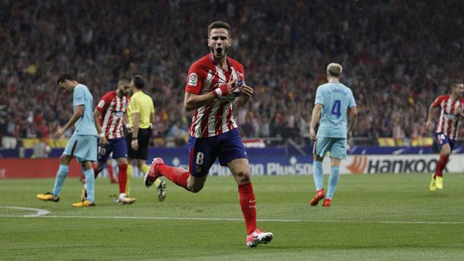 Saul celebrates a goal against Barcelona in the Wanda Metropolitano.