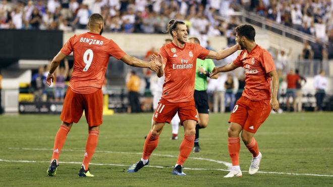 Benzema, Bale y Asensio celebran un gol ante la Roma en pretemporada.