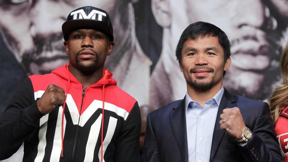 Floyd Mayweather Jr. y Manny Pacquiao, durante el pesaje del combate...