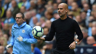 Pep Guardiola looks on during the Premier League match between...