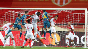 Jose Gimenez heads the ball and scores a goal during the match between...