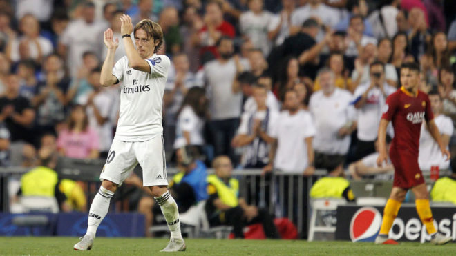 Luka Modric goes off to a standing ovation at the Bernabeu.