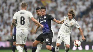 Leganes' forward Guido Carrillo challenges Luka Modric and Toni...