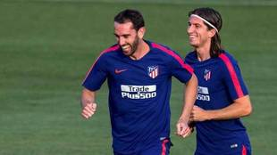 Godín and Filipe Luis, at the Atletico training session.