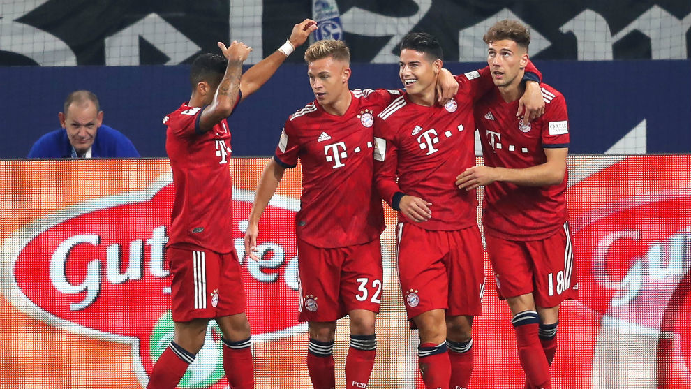 Bayern's James Rodriguez celebrates with his teammates after scoring