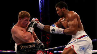 Britain's Anthony Joshua throws a punch at Russia's...