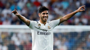 Real Madrid's Spanish midfielder Marco Asensio celebrates after...