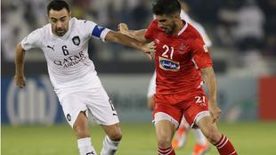 Xavi, durante un lance del partido ante el Persepolis