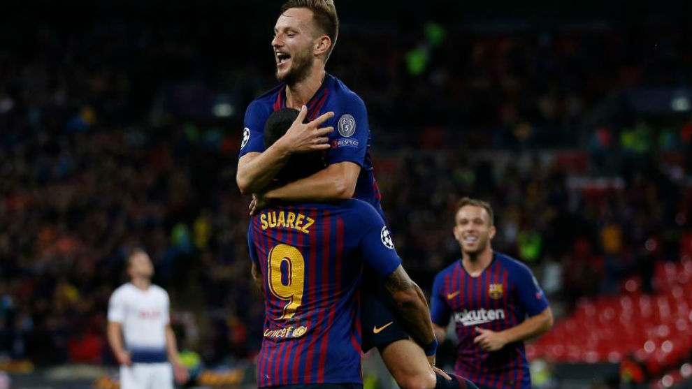 Rakitic celebrates his stunner against Tottenham with Luis Suarez