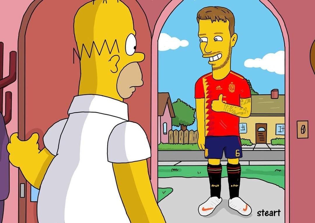 Saúl Ñiguez presentando su dorsal 6 con España a Homer Simpson