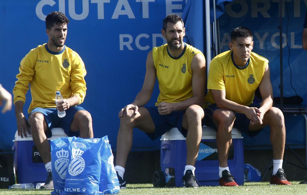 Didac, Diego López y Duarte, presencian el entrenamiento.