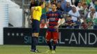 Mateu Lahoz junto a Leo Messi.