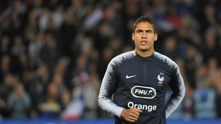 Varane warms up ahead of the friendly football match between France...
