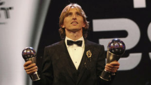 Modric poses for a photo with his The Best FIFA Men's Player Award and...