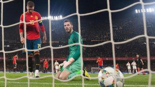 Spain's goalkeeper David de Gea eyes the ball scored by...