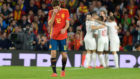 Marcos Alonso reacts after Marcus Rashford scored a goal during the...