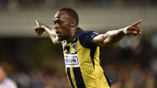 Uaain Bolt celebrates one of his two goals