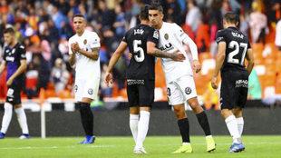 Óscar Rodríguez junto a Jonathan Silva y Ferrán López a la...