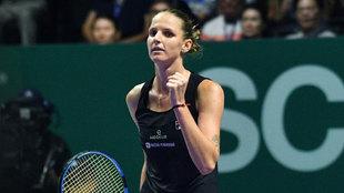 Karolina Pliskova celebra su triunfo en Singapur ante Caroline...