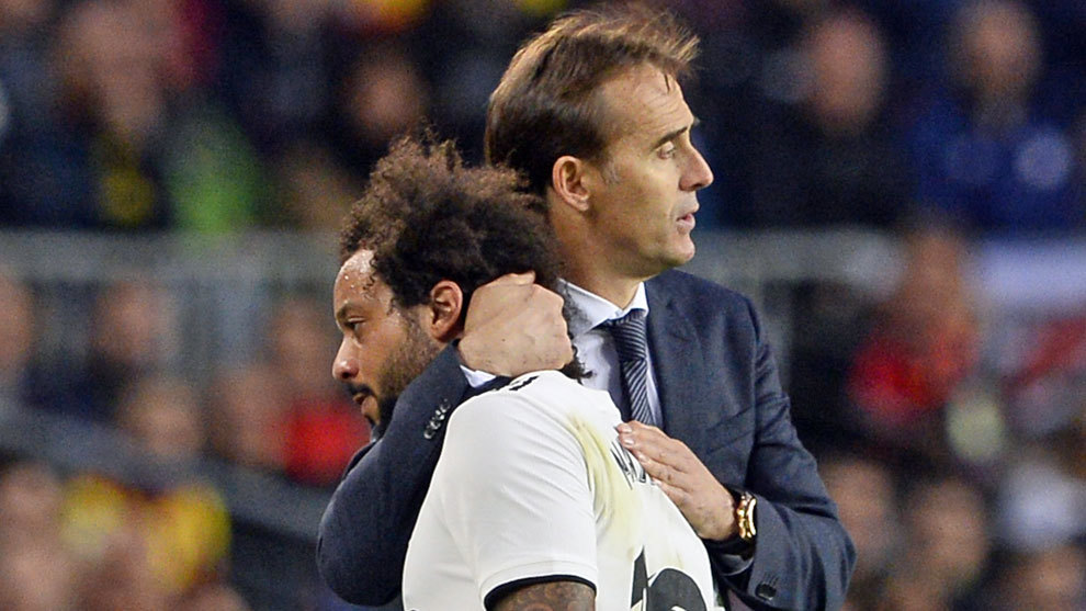 Marcelo is hugged by  Lopetegui as he leaves the pitch during the...
