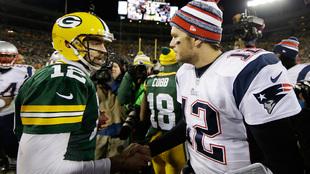 Rodgers y Brady al finalizar el partido de 2014.