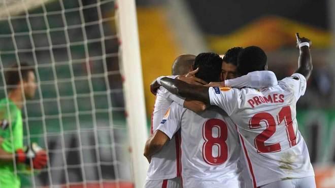 Sevilla's players celebrate a goal.