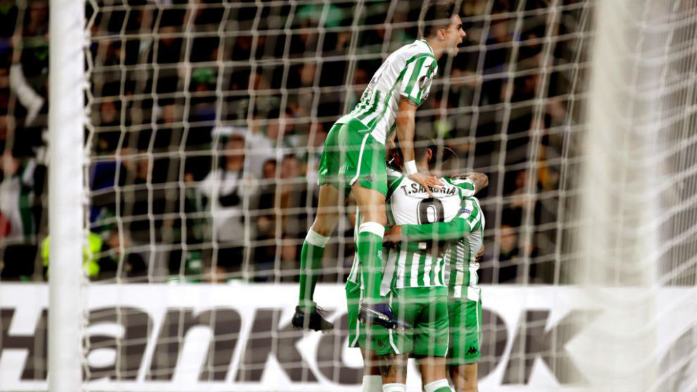 Betis's players celebrate a goal.
