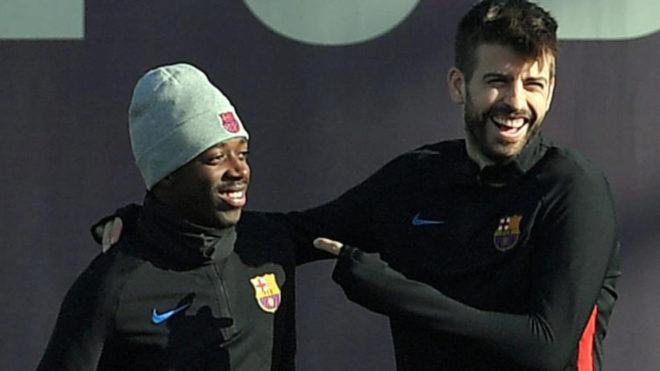 Ousmane Dembele and Gerard Pique