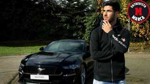 Marco Asensio poses with the new Ford Mustang.