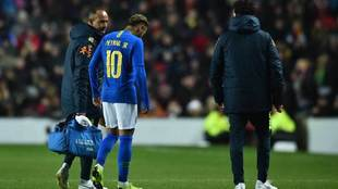 Neymar goes off injured against Cameroon.