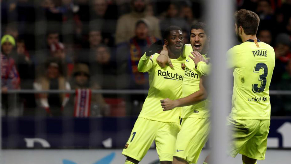 Dembele celebrates  after scoring a goal during the match between...