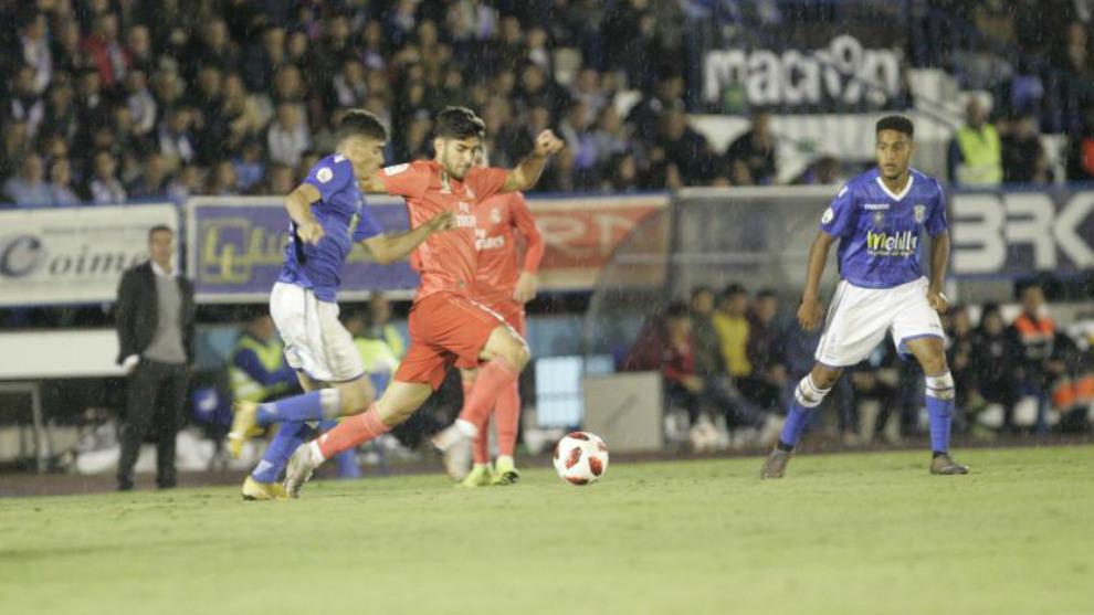 Momento del partido entre el Melilla y el Real Madrid