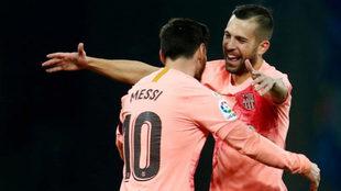 Jordi Alba y Messi.