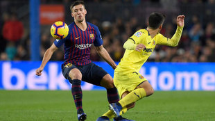 Lenglet (L) vies with Gerard Moreno during the  match FC Barcelona...