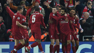 Liverpool's players celebrate the goal.