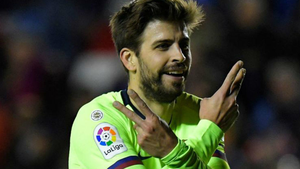 Pique celebrates his goal.