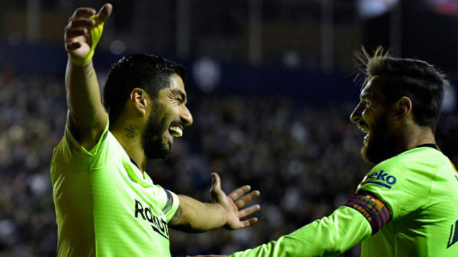 Suarez and Messi celebrate a goal at the Ciutat de Valencia